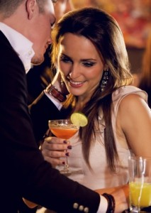 couple in a bar laugh as the man whispers something in the woman's ear 213x300 Sexy things women do without even realizing it