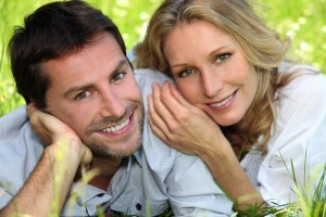 happy couple in grass 300x200 25 Must Follow Relationship Rules for Happy Love