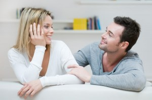 couple on couch talking 300x199 How To Better Connect With Your Guy