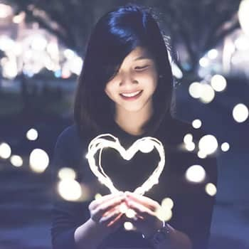 woman heart The ONE Secret To Keeping A Guy Interested In You