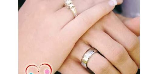 man and woman's hands on top of each other both wearing wedding rings